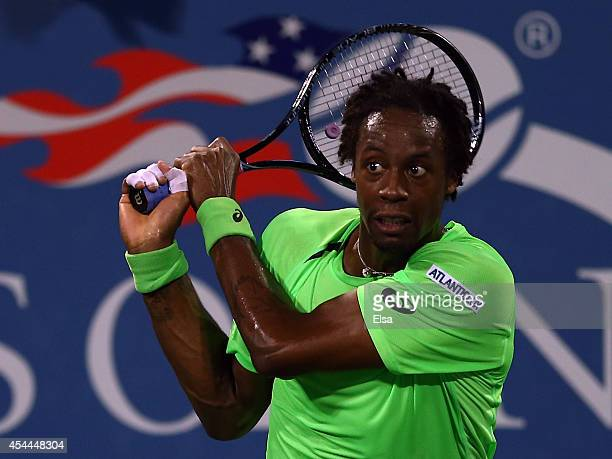 Gael Monfils of France returns a shot to Richard Gasquet of France on Day Seven of the 2014 US Open at the USTA Billie Jean King National Tennis...