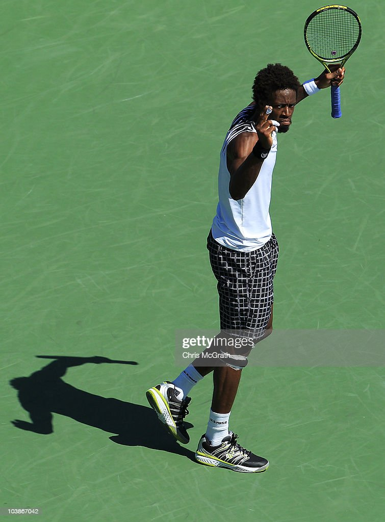 Gael Monfils of France returns reacts against Richard Gasquet of France during his men's singles match on day eight of the 2010 U.S. Open at the USTA Billie Jean King National Tennis Center on September 6, 2010 in the Flushing neighborhood of the Queens borough of New York City.