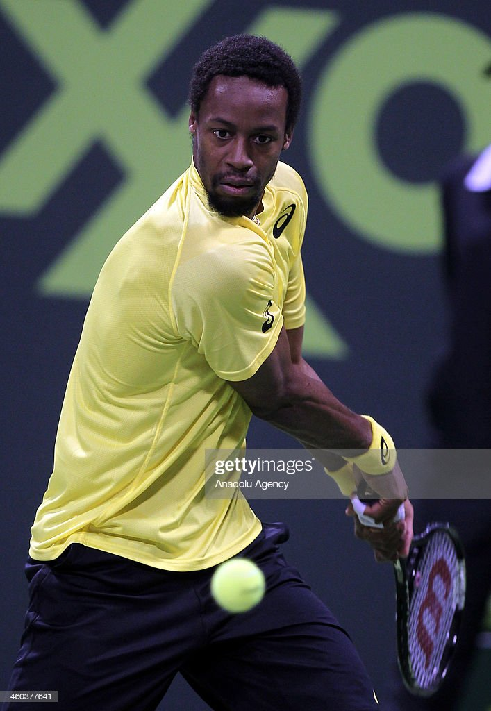 Gael Monfils of France returns the ball to Germany's Florian Mayer during their semifinal tennis match in Qatar ExxonMobil Open tennis tournament at...