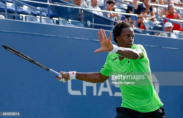Gael Monfils of France returns the ball to Grigor Dimitrov of Bulgaria during men's singles fourth round match on Day Nine of the 2014 US Open at the...
