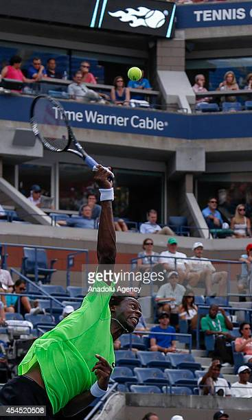 Gael Monfils of France serves against Grigor Dimitrov of Bulgaria during men's singles fourth round match on Day Nine of the 2014 US Open at the USTA...