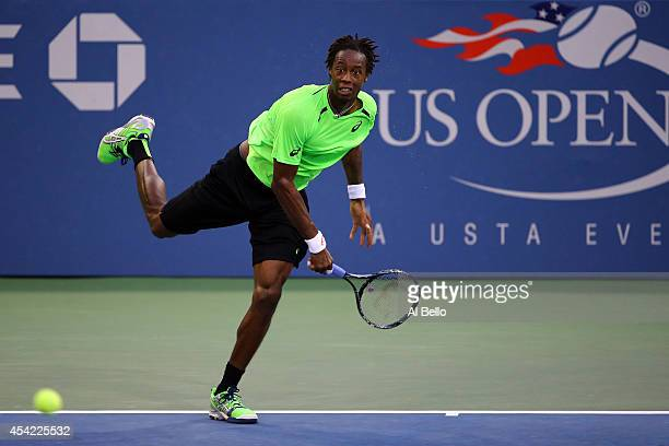 Gael Monfils of France serves against Jared Donaldson of the United States during theirs men's singles first round match on Day Two of the 2014 US...