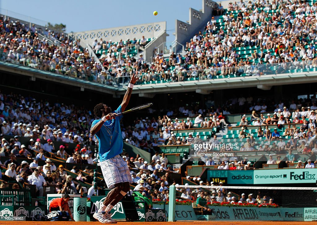 Gael Monfils of France serves during the men's singles first round match between Gael Monfils of France and Dieter Kindlmann of Germany on day two of the French Open at Roland Garros on May 24, 2010 in Paris, France.