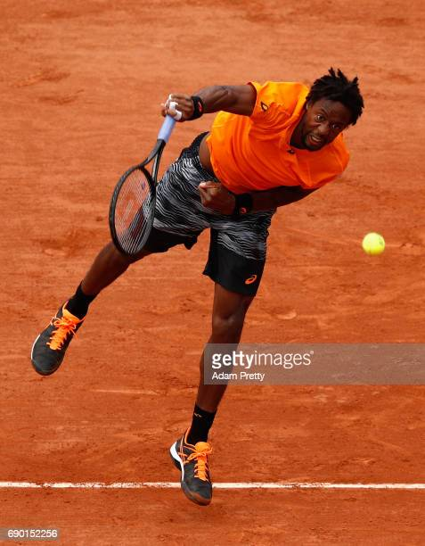 Gael Monfils of France serves during the mens singles first round match against Dustin Brown of Germany on day three of the 2017 French Open at...
