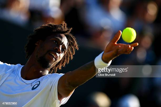 Gael Monfils of France serves in his Gentlemens Singles first round match against Pablo Carreno Busta of Spain during day two of the Wimbledon Lawn...