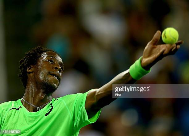 Gael Monfils of France serves the ball to Richard Gasquet of France on Day Seven of the 2014 US Open at the USTA Billie Jean King National Tennis...