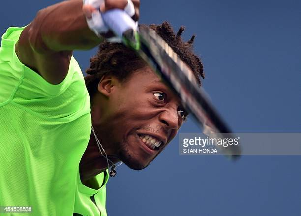 Gael Monfils of France serves to Grigor Dimitrov of Bulgaria during their 2014 US Open men's singles match at the USTA Billie Jean King National...