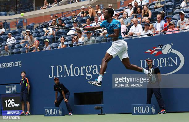 TOPSHOT Gael Monfils of France serves to Jan Satral of Czech Republic during their 2016 US Open Men's Singles match at the USTA Billie Jean King...