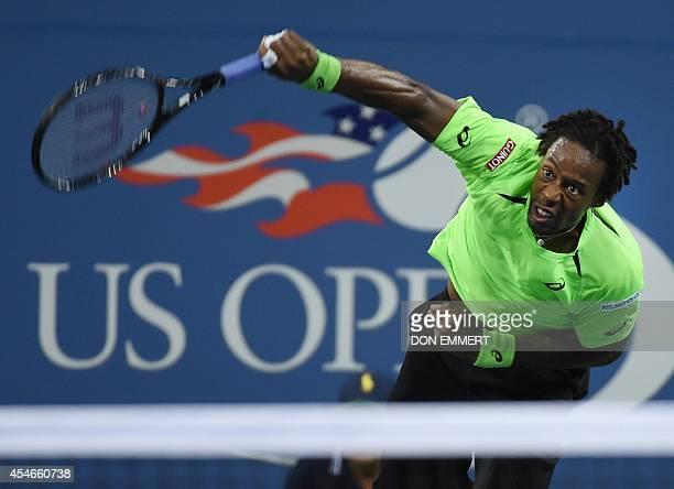 Gael Monfils of France serves to Roger Federer of Switzerland during their US Open 2014 men's singles quarterfinals match at the USTA Billie Jean...