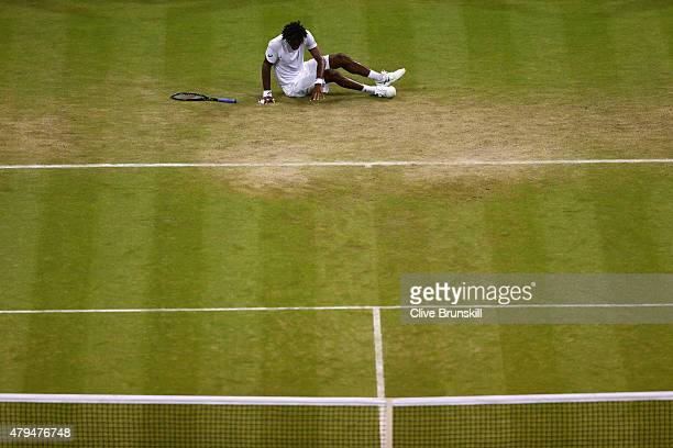 Gael Monfils of France slips on the grass after defeat in his Mens Singles Third Round match against Gilles Simon of France during day six of the...