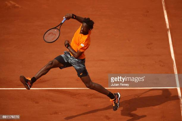 Gael Monfils of France smashes during the men's singles second round match against Thiago Monteiro of Brazil on day five of the 2017 French Open at...