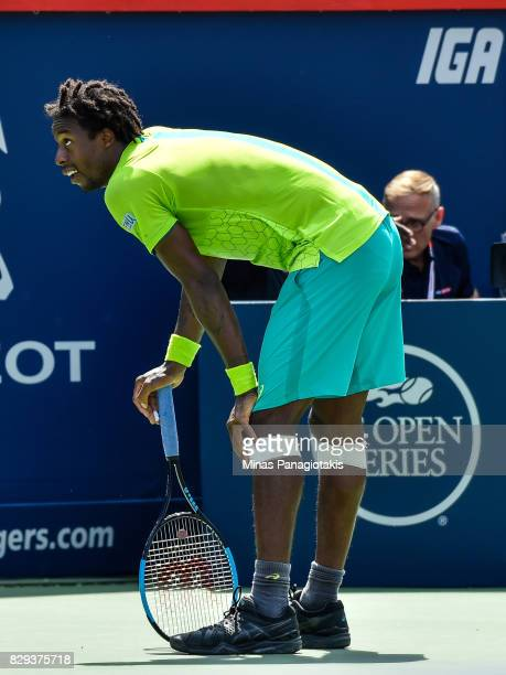 Gael Monfils of France takes a break as the play was challenged against Roberto Bautista Agut of Spain during day seven of the Rogers Cup presented...