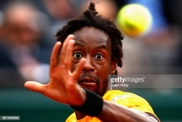 Gael Monfils of France watches the flight of the ball during the mens singles third round match against Richard Gasquet of France on day seven of the...