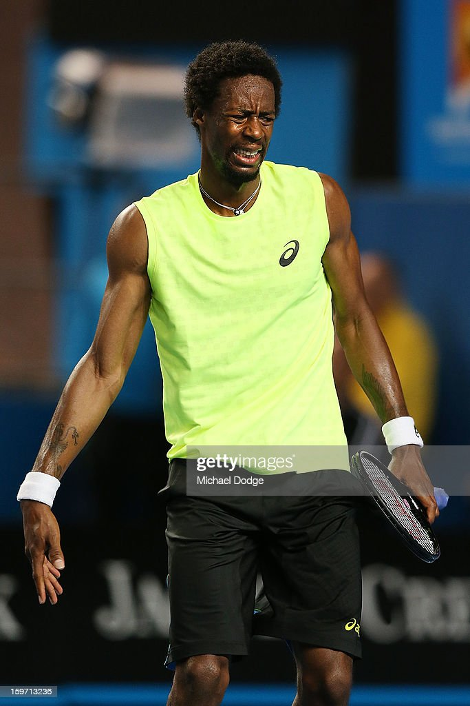 Gael Monfils of Francein pain with his right hand in his third round match against Gilles Simon of France during day six of the 2013 Australian Open at Melbourne Park on January 19, 2013 in Melbourne, Australia.
