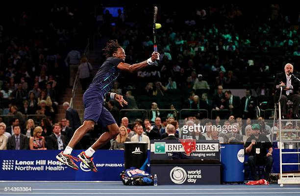 Gael Monfils returns a shot to Stan Wawrinka during their match at the BNP Paribas Showdown at Madison Square Garden on March 8 2016 in New York City