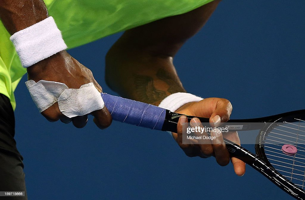 Gael Monfils with his right hand taped up in his third round match against Gilles Simon of France during day six of the 2013 Australian Open at Melbourne Park on January 19, 2013 in Melbourne, Australia.