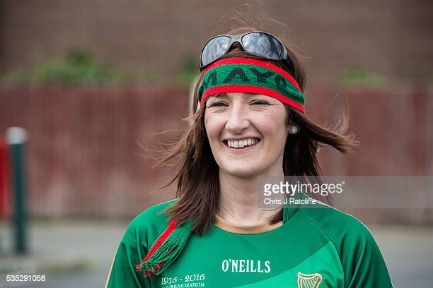 Gaelic football fan Claire Mortimer walks to the pitch as Prime Minister of Ireland Enda Kenny attends an event to meet Irish4Europe campaigners at...