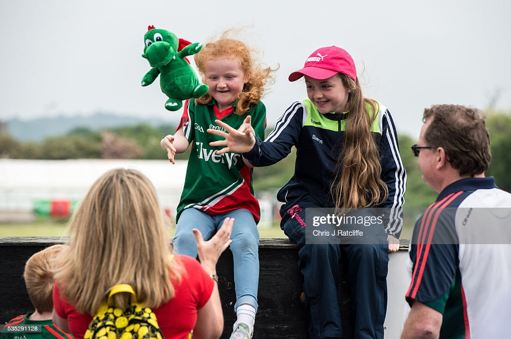 Gaelic football fans and Mayo supporters Clionr Rafter, 6, (L) and Aine Rafter, 11, play catch with a team mascot toy with their parents as Prime Minister of Ireland Enda Kenny attends an event to meet Irish4Europe campaigners at the London v Mayo Gaelic football game on May 28, 2016 in Ruislip, England. Mr Kenny spoke to Irish4Europe campaigners and the media in support of Britain remaining in the European Union. Britain will go to the polls to vote in the European referendum on June 23.