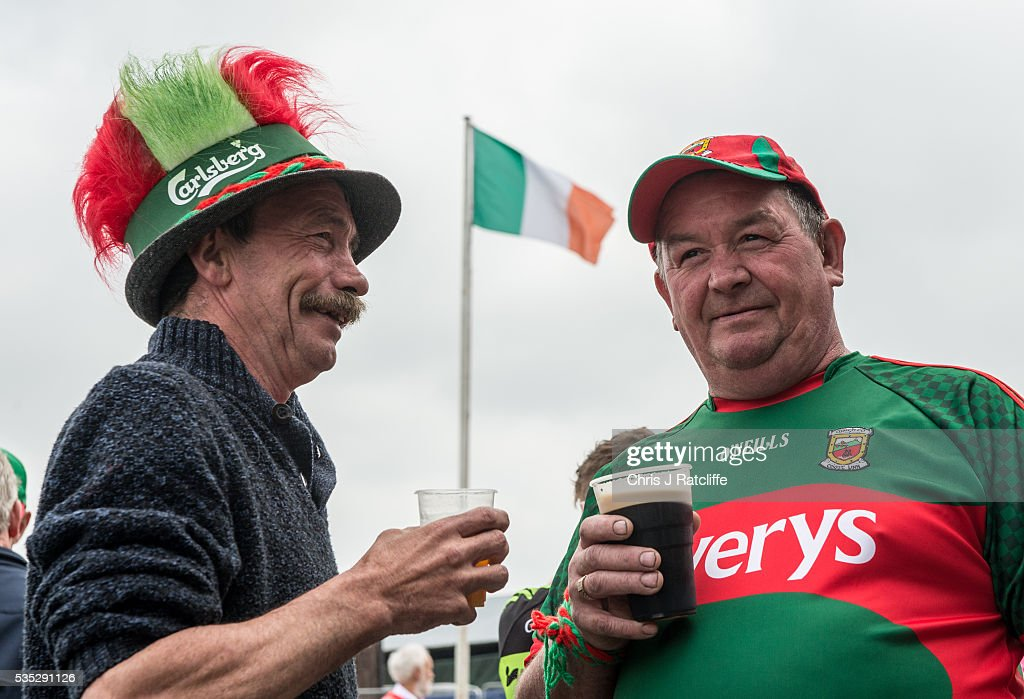 Gaelic football fans and Mayo supporters Joe Horan (L) and Shamus Horan have a drink as Prime Minister of Ireland Enda Kenny attends an event to meet Irish4Europe campaigners at the London v Mayo Gaelic football game on May 28, 2016 in Ruislip, England. Mr Kenny spoke to Irish4Europe campaigners and the media in support of Britain remaining in the European Union. Britain will go to the polls to vote in the European referendum on June 23.