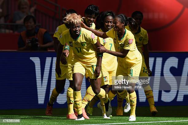 Gaelle Enganamouit of Cameroon celebrates with team mates after scoring her team's second goal during the FIFA Women's World Cup 2015 Group C match...