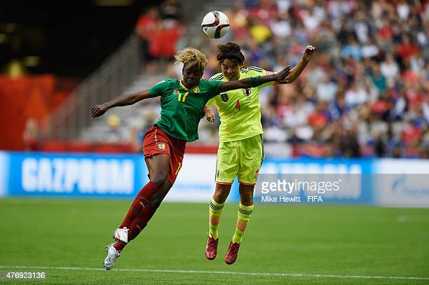 Gaelle Enganamouit of Cameroon is challenged by Saki Kumagai of Japan during the FIFA Women's World Cup 2015 Group C match between Japan and Cameroon...