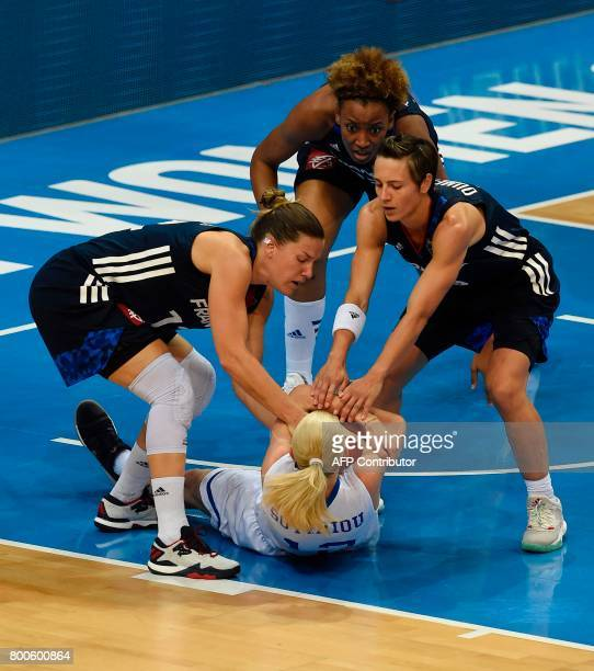 Gaelle Skrela Celine Dumerc and Diandra Tchatchouang of France vie for a ball with Aikaterina Sotiriou of Greece during the FIBA EuroBasket 2017...