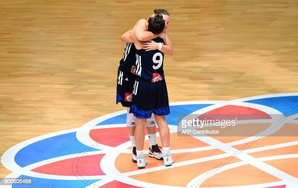 Gaelle Skrela of France celebrates with Celine Dumerc after winning the FIBA EuroBasket 2017 women's semifinal match between Greece and France in...