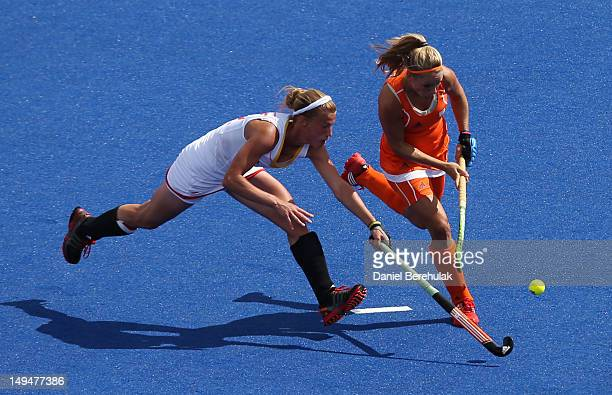 Gaelle Valcke of Belgium competes with Kitty van Male of Netherlands during the Women's Pool WA Match W02 between the Netherlands and Belgium at the...