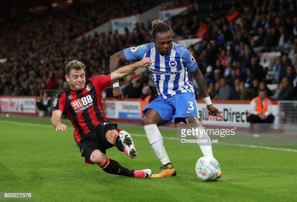 Gaetan Bong of Brighton and Hove Albion crosses as Ryan Fraser of AFC Bournemouth slides in to tackle during the Carabao Cup Third Round match...