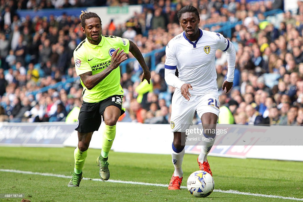 Gaetan Bong of Brighton & Hove Albion FC chases down Jordan Botaka of Leeds United FC during the Sky Bet Championship match between Leeds United and Brighton & Hove Albion at Elland Road on October 17, 2015 in Leeds, England.