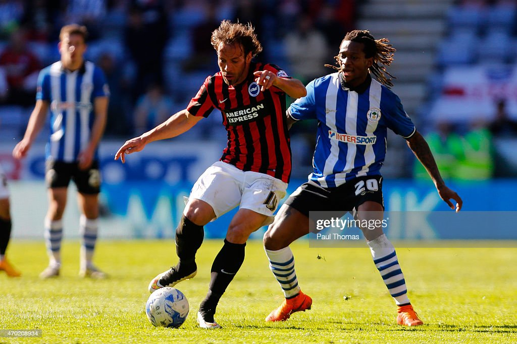 Gaetan Bong (R) of Wigan in action with Inigo Calderon of Brighton during the Sky Bet Championship match between Wigan Athletic and Brighton & Hove Albion at the DW Stadium on April 18, 2015 in Wigan, England.
