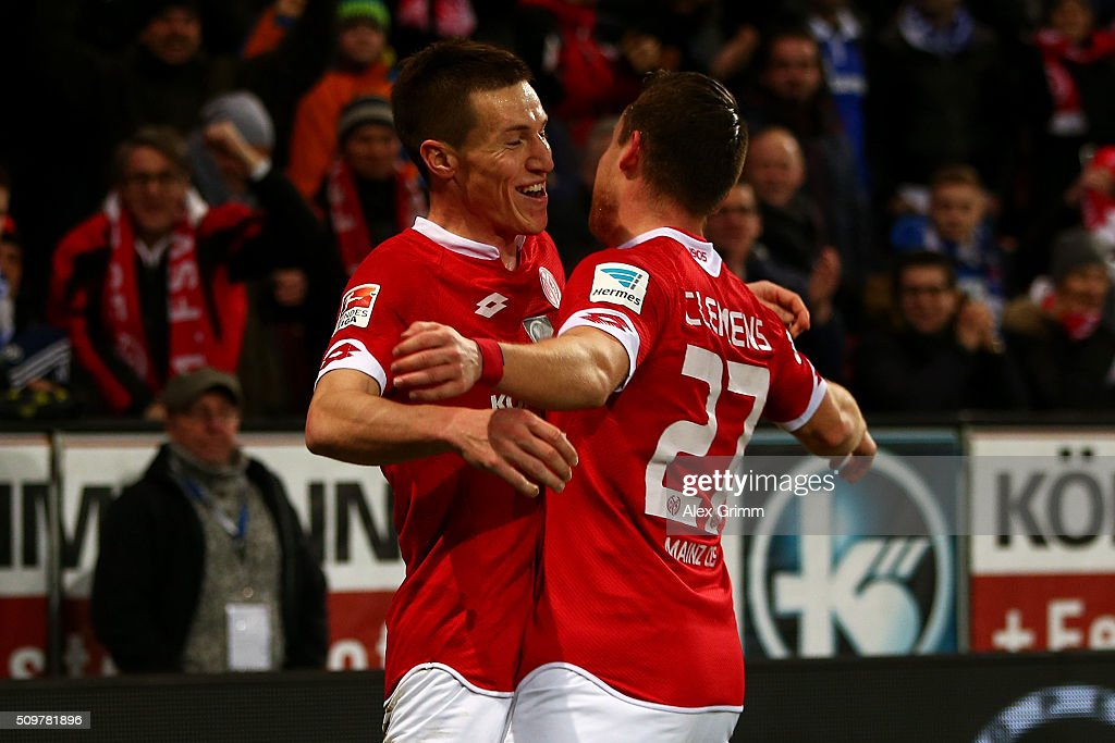 Gaetan Bussmann of 1. FSV Mainz 05 celebrates with team-mate Christian Clemens after scoring the opening goal during the Bundesliga match between 1. FSV Mainz 05 and FC Schalke 04 at Coface Arena on February 12, 2016 in Mainz, Germany.