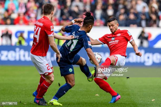 Gaetan Bussmann of Mainz 05 and Danny Latza of Mainz 05 challenge Daniel Didavi of Wolfsburg during the Bundesliga match between 1 FSV Mainz 05 and...