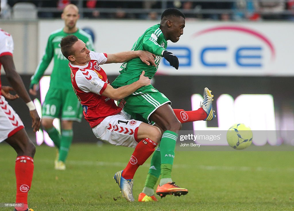 Gaetan Courtet of Reims and Josuha Guilavogui of ASSE in action during the french Ligue 1 match between Stade de Reims and AS Saint-Etienne at the Stade Auguste Delaune on February 17, 2013 in Reims, France.