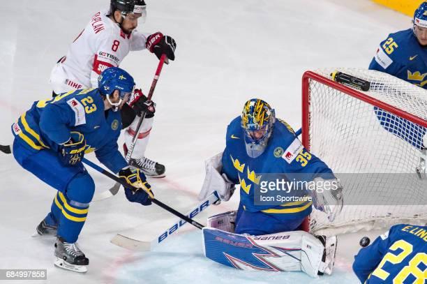 Gaetan Haas scores a goal against Goalie Henrik Lundqvist during the Ice Hockey World Championship Quarterfinal between Switzerland and Sweden at...
