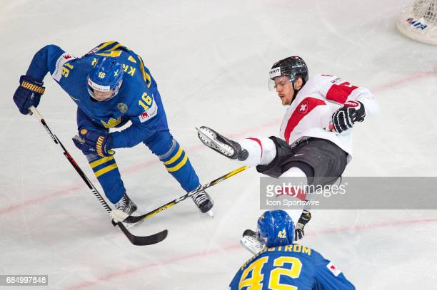 Gaetan Haas vies with Marcus Kruger during the Ice Hockey World Championship Quarterfinal between Switzerland and Sweden at AccorHotels Arena in...