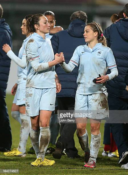Gaetane Thiney and Laure Boulleau of France congratulate each other after the women international friendly match between France and Brazil at the...