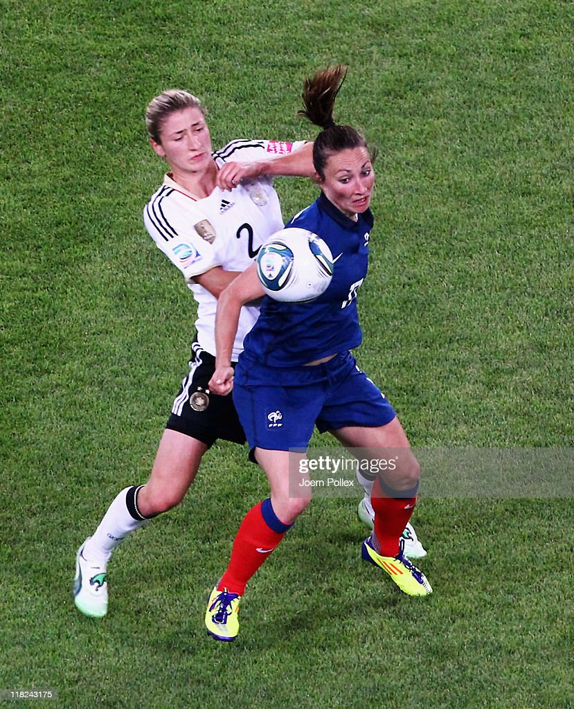 Gaetane Thiney (R) of France and Bianca Schmidt of Germany battle for the ball during the FIFA Women's World Cup 2011 Group A match between France and Germany at Borussia Park Stadium on July 5, 2011 in Moenchengladbach, Germany.