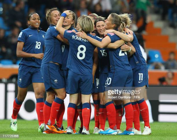 Gaetane Thiney of France celebrates her goal with team mates during the FIFA Women's World Cup 2011 Group A match between Canada and France at the...