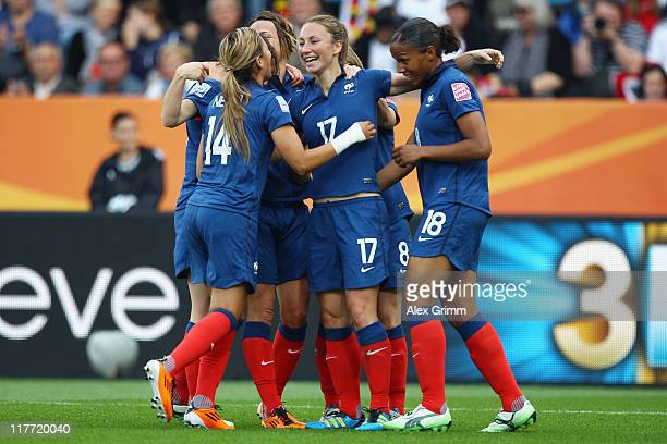 Gaetane Thiney of France celebrates her team's first goal with team mates during the FIFA Women's World Cup 2011 Group A match between Canada and...