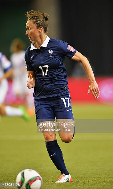 Gaetane Thiney of France is challenged by of Korea during the FIFA Womens's World Cup round of 16 match between France and Korea at Olympic Stadium...