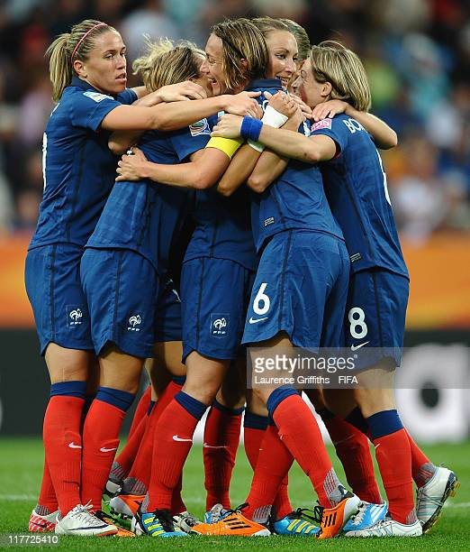 Gaetane Thiney of France is congratulated on scoring the second goal during the FIFA Women's World Cup 2011 Group A match between Canada and France...