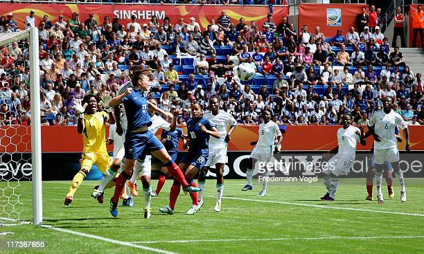 Gaetane Thiney of France jump for a header during the FIFA Women's World Cup 2011 Group A match between Nigeria and France at RheinNeckar Arena on...