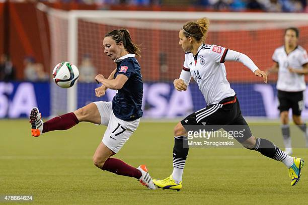 Gaetane Thiney of France plays the ball with Babett Peter of Germany following close behind during the 2015 FIFA Women's World Cup quarter final...