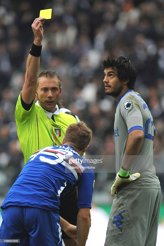 Gaetano Berardi of UC Sampdoria receives the yellow card from referee Paolo Valeri during the Serie A match between Juventus FC and UC Sampdoria at Juventus Arena on January 6, 2013 in Turin, Italy.