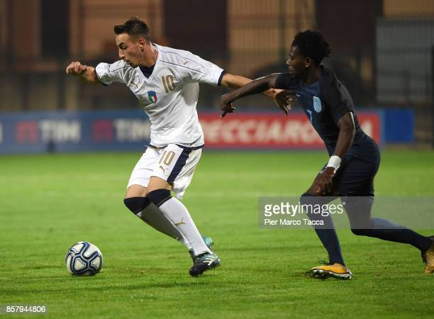 Gaetano Castrovilli of Italy U20 competes for the ball with Isaac BurckleyRicketts of England U20 during the 8 Nations Tournament match between Italy...