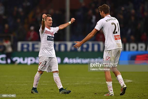 Gaetano Letizia and Simone Romagnoli of Carpi FC celebrate victory at the end of the Serie A match between Genoa CFC and Carpi FC at Stadio Luigi...