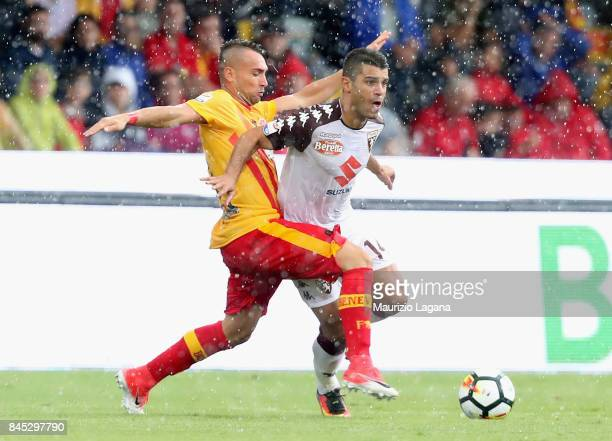 Gaetano Letizia of Benevento competes for the ball with Iago Falque of Torino during the Serie A match between Benevento Calcio and Torino FC at...