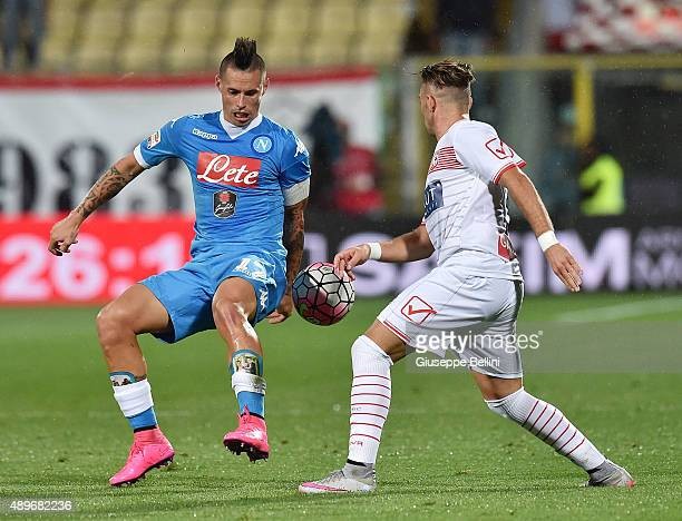 Gaetano Letizia of Carpi and Marek Hamsik of Napoli in action during the Serie A match between Carpi FC and SSC Napoli at Alberto Braglia Stadium on...
