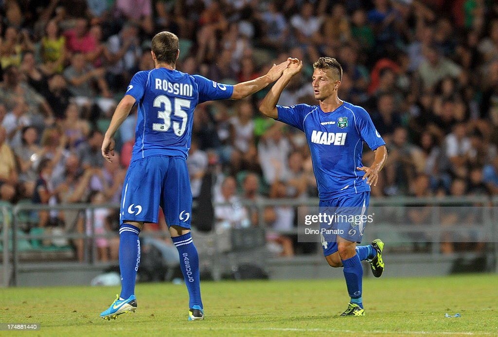 Gaetano Masucci (R) of US Sassuolo celebrates their second goal with <a gi-track='captionPersonalityLinkClicked' href=/galleries/search?phrase=Jonathan+Rossini&family=editorial&specificpeople=5780827 ng-click='$event.stopPropagation()'>Jonathan Rossini</a> during the TIM Preseason Tournament between US Sassuolo, FC Juventus and AC Milan at Mapei Stadium - Città del Tricolore on July 23, 2013 in Reggio nell'Emilia, Italy.